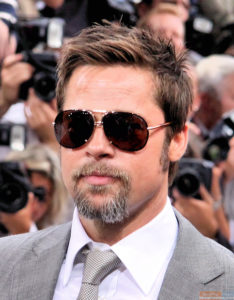 Sunglasses add sex appeal .(Like Brad Pitt needs an extra helping!)